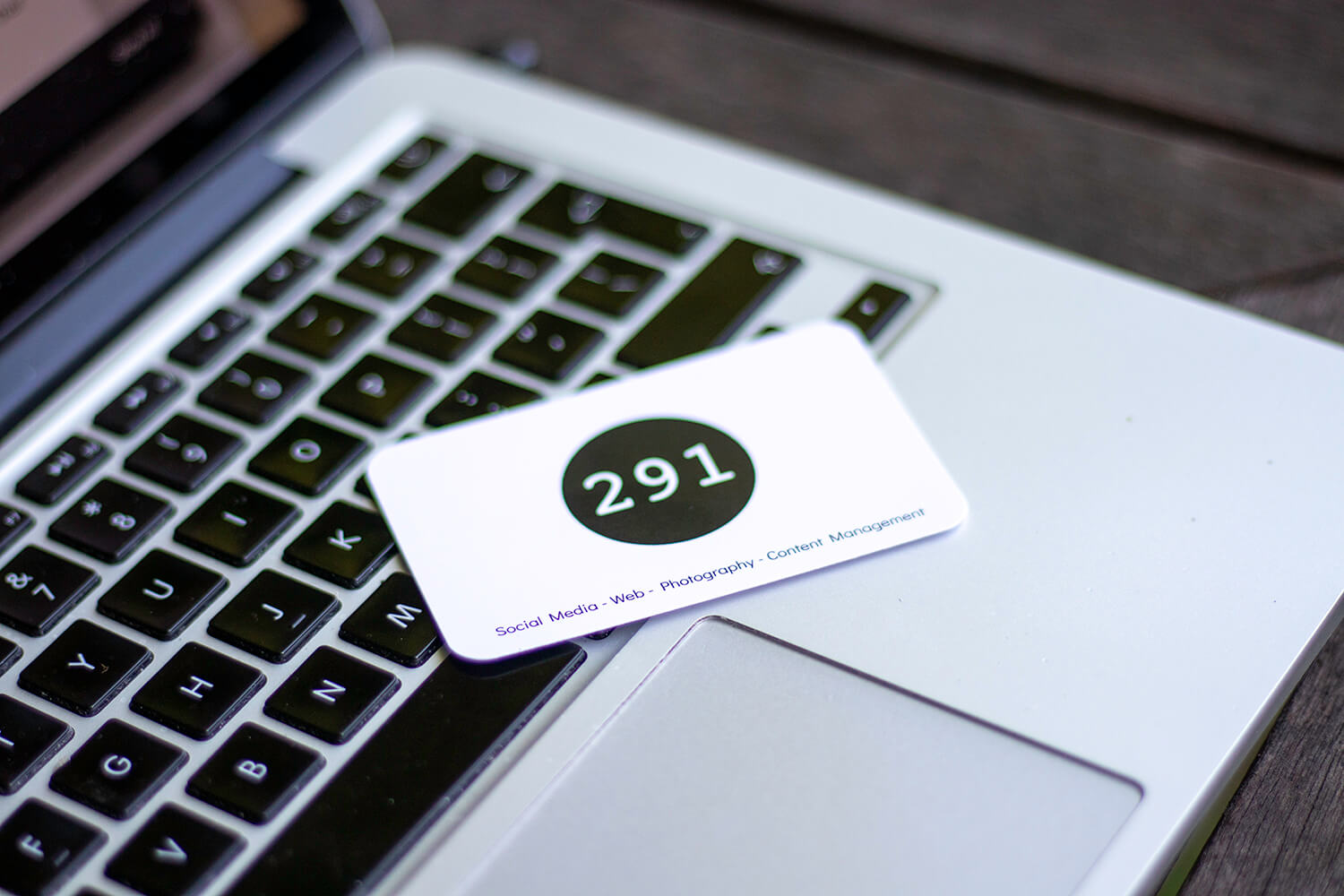 291 Media business card on a Macbook offering a digital audit