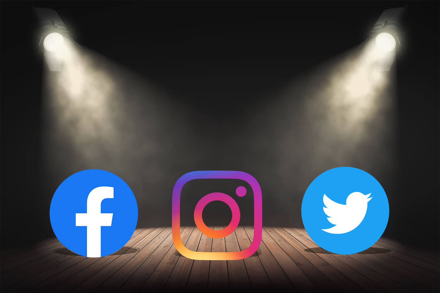 Social media icons on stage lit by two spotlights